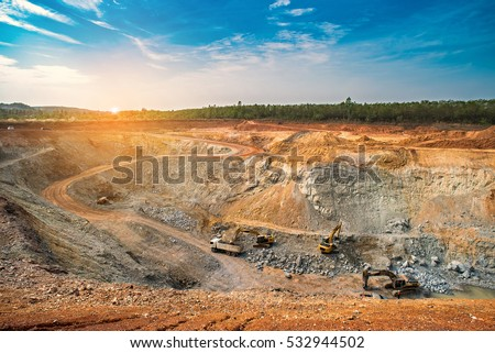 Aerial view of opencast mining quarry with lots of machinery at work - view from above.This area has been mined for copper, silver, gold, and other minerals,Thailand
