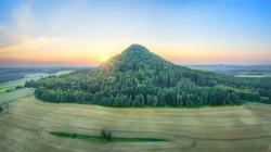 Aerial view of Ostrzyca Proboszczowska - extinct volcano, or rather a volcanic chimney located in Lower Silesia, Poland