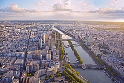 Aerial view of Paris and Seine river from Eiffel tower at sunset.