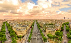 Aerial view of Paris skyline from Arc de Triomphe at sunset light. Triumphal Arch in Place Charles de Gaulle with Avenues Champs Elysees street in front. Scenic urban cityscape