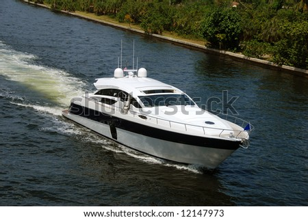 Aerial view of passing luxurious private yacht