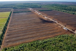 Aerial view of peat harvesting field. Peat extraction