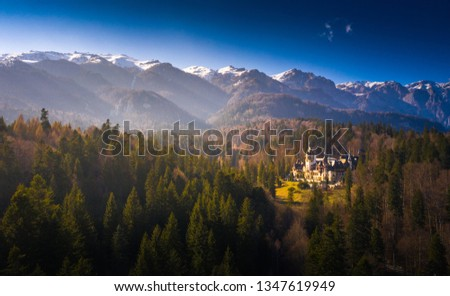 Aerial view of Peles Castle with Bucegi Mountains in background Foto stock ©