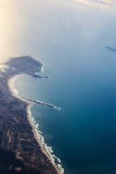 Aerial View of Peniche and baleal. Popular surf spots in Portugal near Lisbon and Atlantic Ocean. View from the porthole of an airplane.