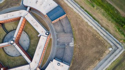 Aerial view of penitentiary prison. Aerial photo of a prison. close up aerial view of a European jail or prison.