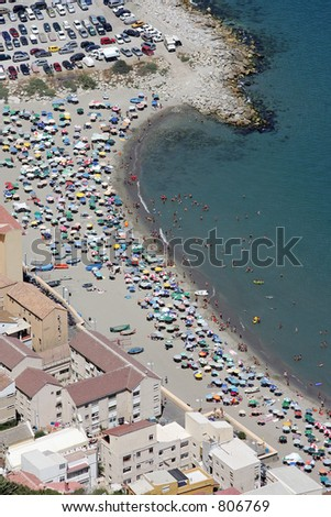 Aerial view of people sunbathing on the beach in Gibraltar as seen from the top of the rock