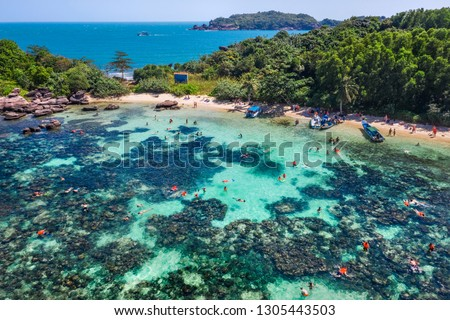 Photo of Aerial view of people swimming on the sea and beach on Gam Ghi Phu Quoc island in Thailand bay, Kien Giang, Vietnam.