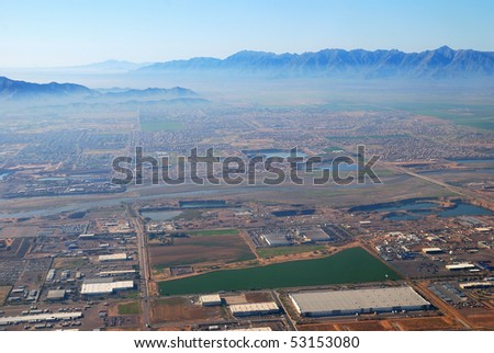 Aerial view of Phoenix city with buildings and CamelBack mountain in Arizona.