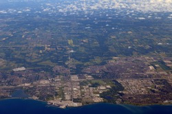 Aerial view of Pickering and the Nuclear Generating Station on Lake Ontario