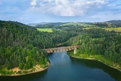 Aerial view of Pilchowicki bridge - old steel truss railway bridge over the Pilchowickie Lake in Lower Silesia, Poland