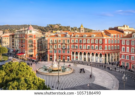 Aerial view of Place Massena square with red buildings  and fountain in Nice, France #1057186490