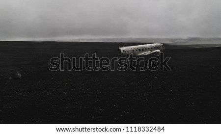 aerial view of plane wreck in iceland with no people, drone