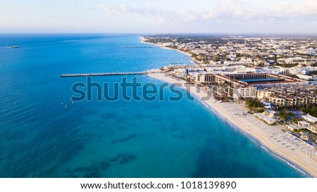 Shutterstock Aerial view of Playa Del Carmen, Mexico showing luxury resorts and blue turquoise beach during sunrise