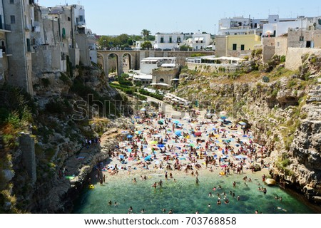 Aerial view of Polignano a mare beach and cliffs, Apulia, southern Italy