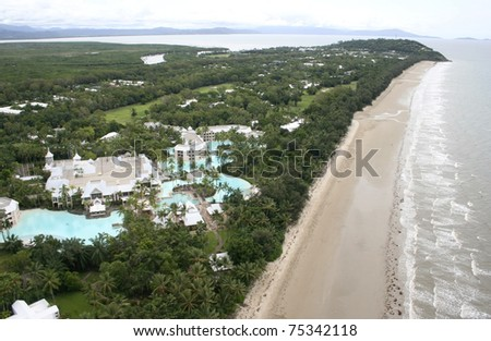 Aerial view of Port Douglas looking north along four mile beach, Queensland, Australia