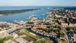 Aerial view of port of Klaipeda, a cargo ship terminal on the shore of Baltic sea during summer evening.