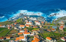 Aerial view of Porto Moniz town, famous for its natural volcanic lava pools. Madeira