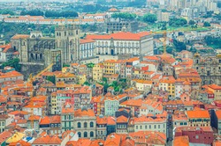 Aerial view of Porto Oporto city historical centre with red tiled roof typical buildings houses, Porto Cathedral or Se do Porto and Vila Nova de Gaia city background, Norte or Northern Portugal