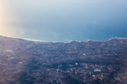 Aerial View of Portugal and Atlantic Ocean. View from the porthole of an airplane.