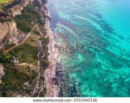 Aerial view of promontory of the Calabrian coast overlooking the sea, town of Riaci, Tropea, Calabria, Italy. Beaches and crystal clear sea. Paths that run along headlands to admire the coast #1555445138