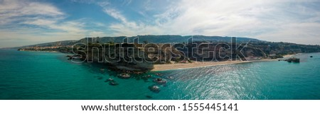 Aerial view of promontory of the Calabrian coast overlooking the sea, town of Riaci, Tropea, Calabria, Italy. Beaches and crystal clear sea. Paths that run along headlands to admire the coast #1555445141