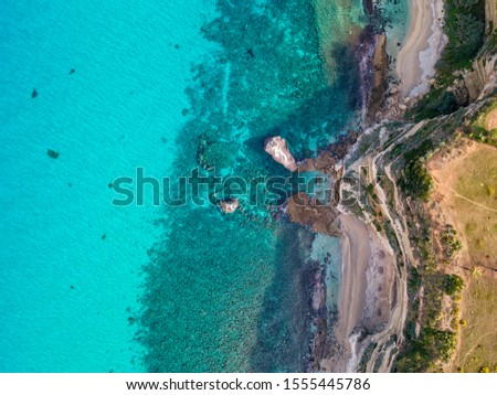 Aerial view of promontory of the Calabrian coast overlooking the sea, town of Riaci, Tropea, Calabria, Italy. Beaches and crystal clear sea. Paths that run along headlands to admire the coast #1555445786