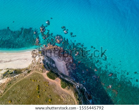 Aerial view of promontory of the Calabrian coast overlooking the sea, town of Riaci, Tropea, Calabria, Italy. Beaches and crystal clear sea. Paths that run along headlands to admire the coast #1555445792