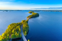 Aerial view of Pulkkilanharju Ridge, Paijanne National Park, southern part of Lake Paijanne. Landscape with drone. Blue lakes, road and green forests from above on a sunny summer day in Finland
