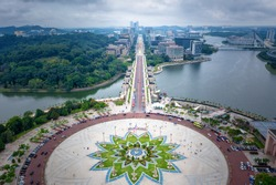 Aerial View Of Putrajaya City Centre with Lake at sunset in Putrajaya, Malaysia.