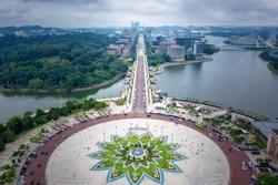 Aerial View Of Putrajaya City Centre with Lake at sunset in Putrajaya, Malaysia.