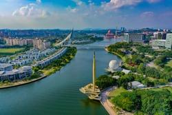 Aerial View Of Putrajaya Lake With Monument Tower And Putrajaya Bridge View