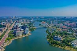 Aerial View Of Putrajaya Lake With Straight Main Road And Putrajaya Bridge View