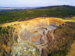 Aerial view of quarry, open pit mining stone. Stone mining in Brdy mountains, Czech republic, Europe. Industrial landscape from above.