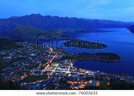 aerial view of Queenstown at dusk with the remakable range and lake wakatipu background