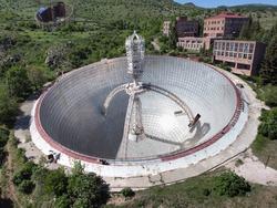 Aerial View of Radio-Optical Telescope, Giant Radio Astronomical Telescope surrounded by mountains. Drone shot of Orgov Radio-Optical Telescope in Armenia