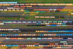 Aerial view of rail sorting freight station with railway cars, with many rail tracks railroad. Heavy industry landscape on evening sunset light