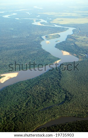 Aerial view of rainforest at the Araguaia River on the border of the states of Mato Grosso and Goias in Brazil - stock photo