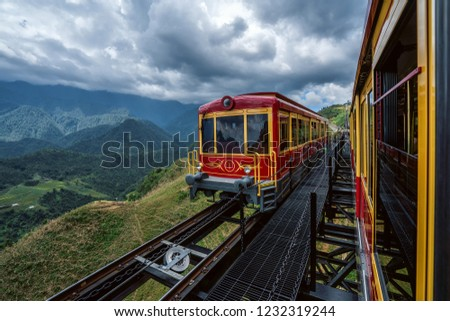 Aerial view of Red tram retro style run to the top hill with passenger  to Fansipan mountain, Fansipan tram, Sapa, Lao Cai, Vietnam.
