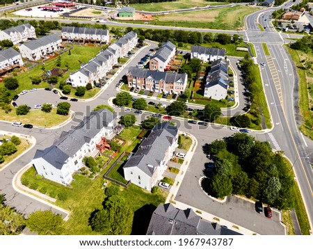 Aerial view of residential houses at summer. American neighborhood, suburb. Real estate, drone shots, sunset, sunlight, from above. ストックフォト ©