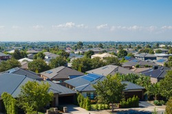Aerial view of residential houses in Melbourne's suburb. Elevated view of Australian homes against blue sky. Copy space for text. Point Cook, VIC Australia.