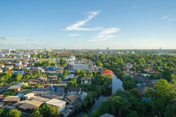 Aerial view of residential houses with nature trees, Wutthakat district, Bangkok City, Thailand in urban city in Asia. Residential houses, buildings at noon.