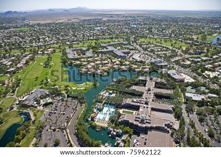 Aerial view of resort hotel with pool and golf activities in Scottsdale, Arizona