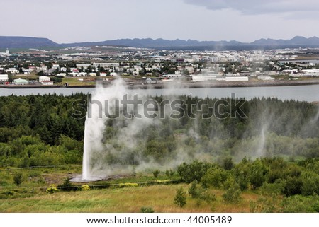Aerial view of Reykjavik from Perlan. Cloudy day. Artificial geyser fountain.