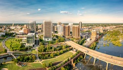 Aerial view of Richmond, Virginia, at sunset. Richmond is the capital city of the Commonwealth of Virginia. Manchester Bridge spans James River
