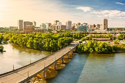 Aerial view of Richmond, Virginia, at sunset. Richmond is the capital city of the Commonwealth of Virginia. Mayo Bridge spans James River