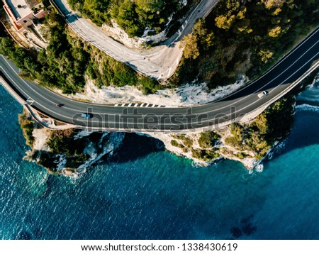 Aerial view of road going along the mountain and ocean or sea. Drone photography from above #1338430619