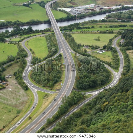 aerial view of road junction beside river