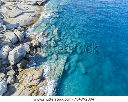 Aerial view of rocks on the sea. Overview of the seabed seen from above, transparent water #754992394