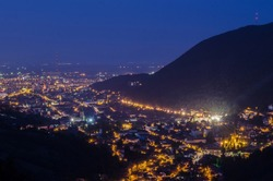 aerial view of romanian city brasov during night