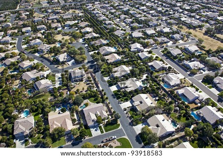 Aerial view of rooftops and swimming pools in east Mesa, AZ